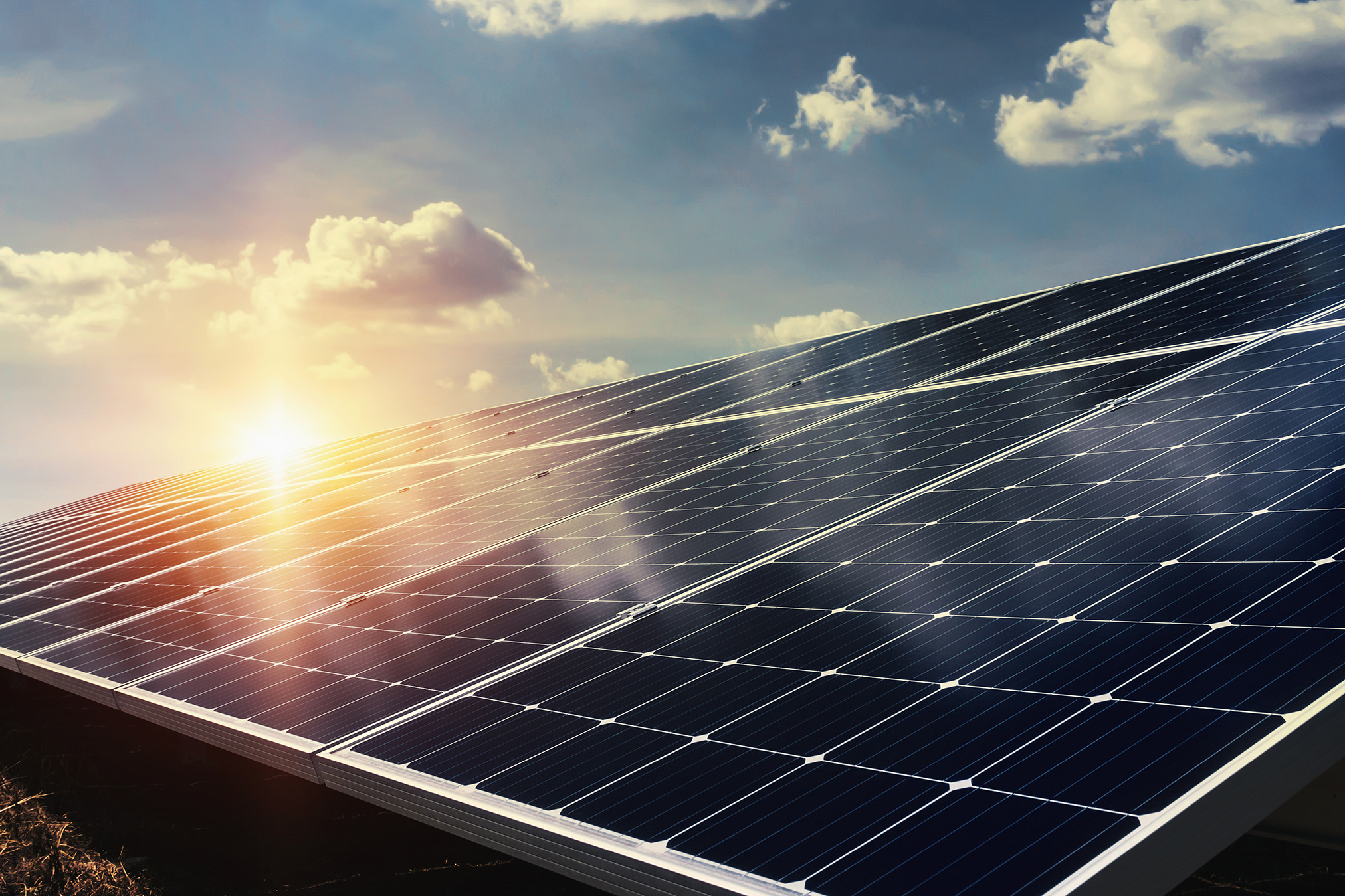 solar panel with sunlight and blue sky background. concept clean